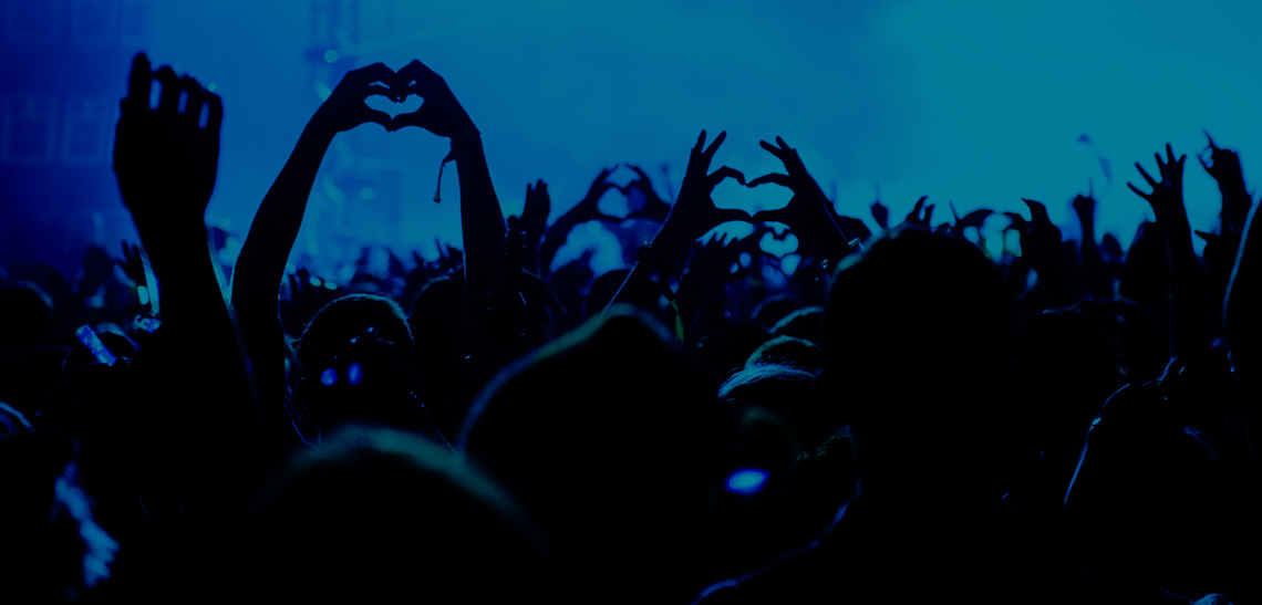 Crowd with heart hands